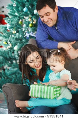 Happy Family With Christmas Present