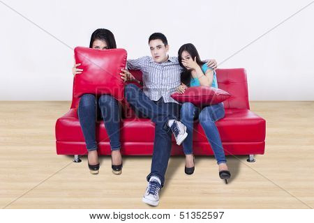 Three Young Friends Watching Tv