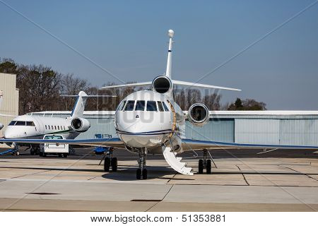 Two Private Jets By Hangers