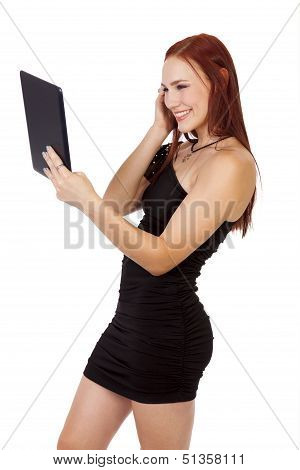 Beautiful Woman With Red Hair Smiles While Using A Tablet Computer.