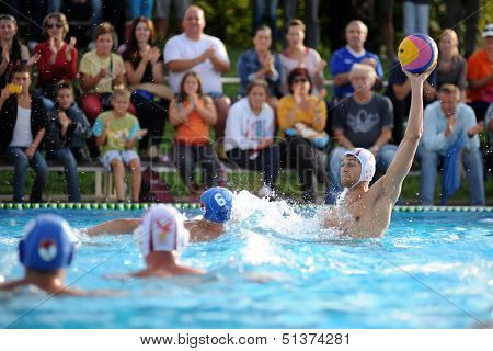 KAPOSVAR, HUNGARY - SEPTEMBER 15: Unidentified players in action at a Hungarian championship water-polo game between Kaposvar (white) and Honved (blue) on September 15, 2013 in Kaposvar, Hungary