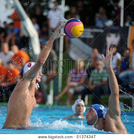 KAPOSVAR, HUNGARY - SEPTEMBER 15: Jozsef Berta (5) in action at a Hungarian championship water-polo game between Kaposvar (white) and Honved (blue) on September 15, 2013 in Kaposvar, Hungary