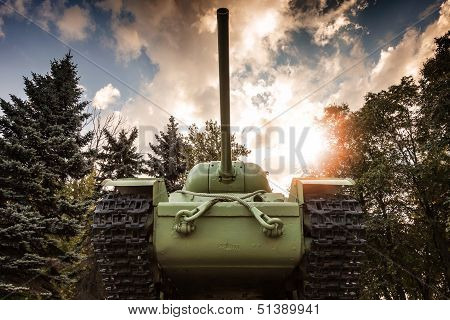 Soviet heavy KV-85 tank from the Second World War with forest and dramatic sky on a background. Monument in St-Petersburg poster