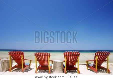 Four Chairs By The Beach