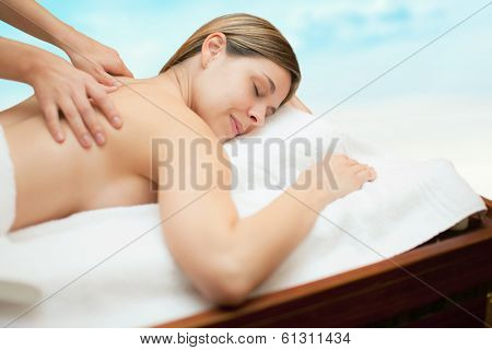 Relaxed woman receiving a massage