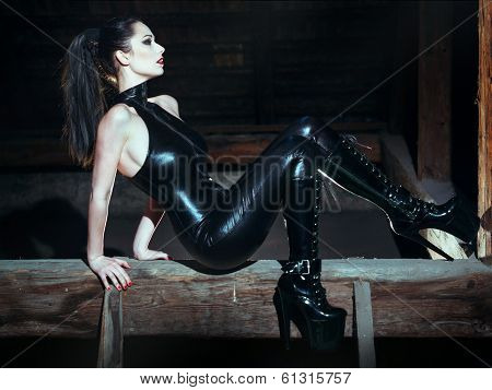 Sexy Dominatrix At Night Posing On Timber