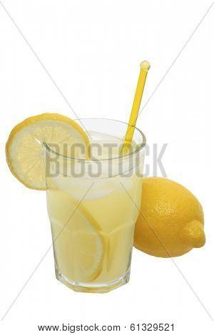 Lemonade in glass with full lemon on white background