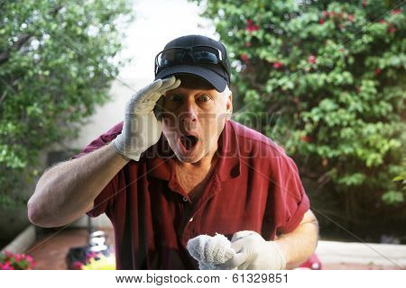 A Window Washer looks is shocked and surprised at what he sees going on Inside the house while he washes the windows on the outside. The perfect humorous window washer image for all your needs.