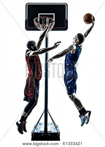 two men caucasian and african basketball players competition jumping dunking in silhouette isolated white background