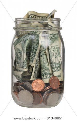 Jar full of money on white background