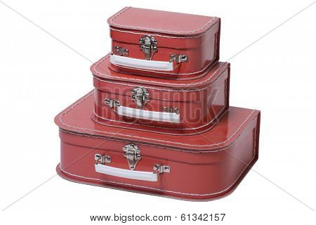 three red leather suitcases on white
