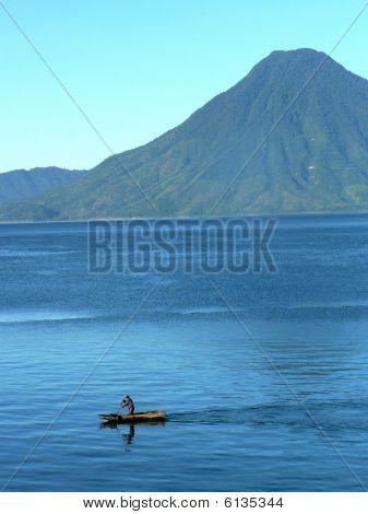 Canoe On Lake With Volcano