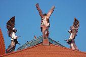 Copper brazen angel on the top of a Catholic church. Csikszereda Miercurea Ciuc Romania poster