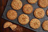 Freshly baked snickerdoodle cookies on slate serving tray as seen from above.  Rustic still life wit