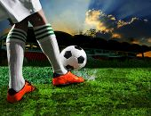 soccer football players in sport stadium with dusky sky background poster