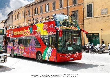 Tourist Bus With Passengers On Street In Rome, Italy