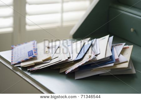 Closeup of letters on writing desk at home