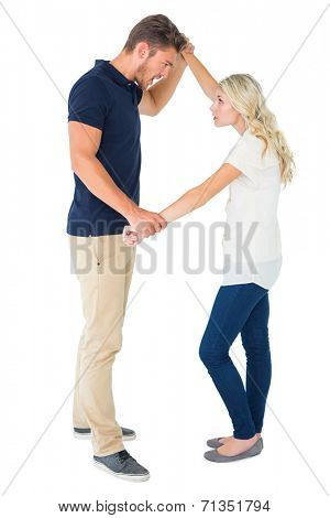 Angry man overpowering his girlfriend on white background