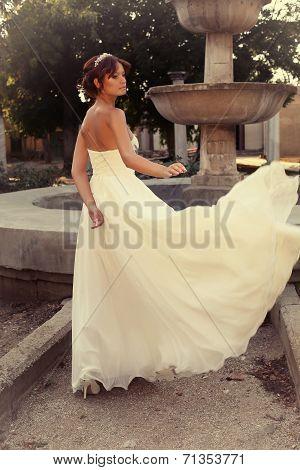 Beautiful Bride In Elegant Wedding Dress Posing At Park