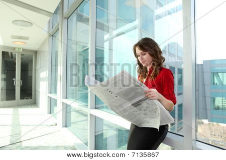 Business Woman Reading Newspaper