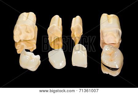 Dental ceramic crowns on isolated black background poster