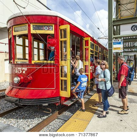 Passengers Enter The Famous Red Riverfront Street Car In New Orleans