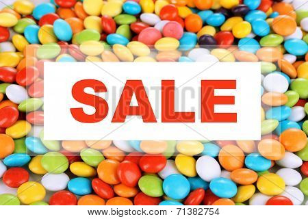 Concept of discount. Colorful candies close up