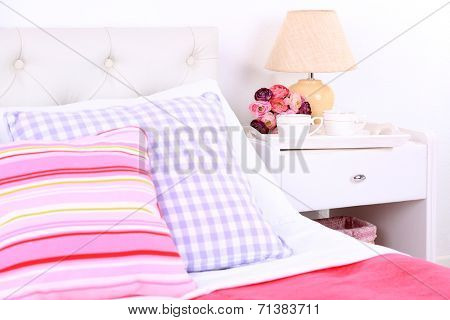 Comfortable soft bed in room poster