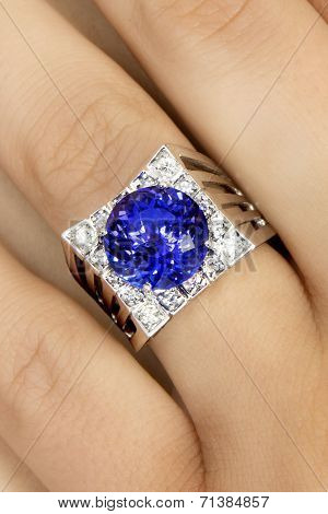 Closeup of Designer Ring with Tanzanite and Diamonds, on a finger