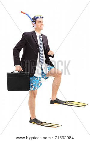 Full length portrait of a businessman walking with scuba fins isolated on white background