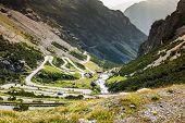 serpentine mountain road in Italian Alps Stelvio pass Passo dello Stelvio Stelvio Natural Park poster