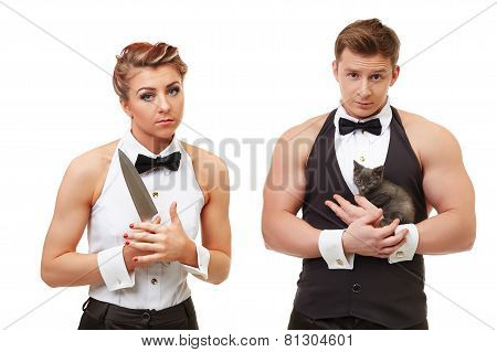 Cute girl with knife and brutal man holding kitten