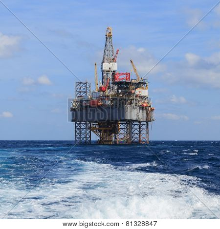 Offshore Jack Up Drilling Rig Over The Production Platform in The Middle of The Sea poster