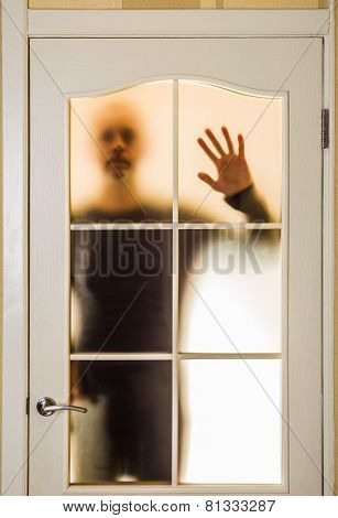 Man Behind The Glass Door