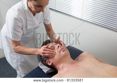 A Man Having A Chinese Massage On Table Massage