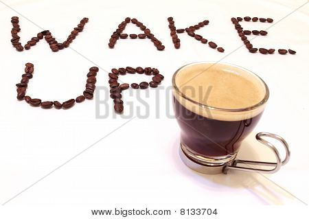 Wake-up written with coffee grain and coffee cup