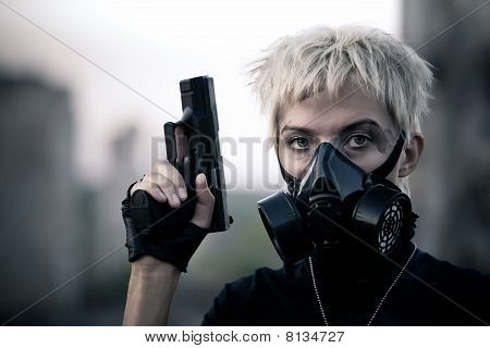 Blond Woman With The Pistol