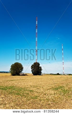 Radio installation in golden acres with blue sky poster