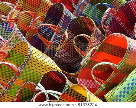 Rows of brightly-colored shopping baskets on a slant