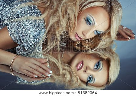 Woman Is Reflected In A Mirror.