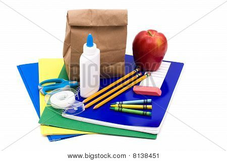 A bunch of school supplies with paper bag lunch back to school poster