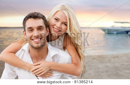 summer holiday, vacation, dating and travel concept - happy couple having fun over tropical beach background