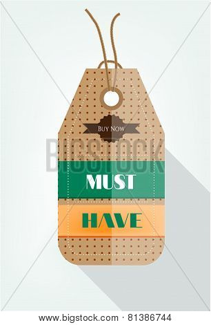 One brown, hanging sticker with pattern and text Must Have, Buy Now