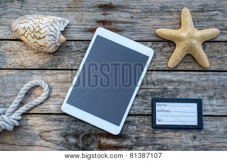 Wooden Background With Starfish, Tablet And Shell - Maritime Decoration.