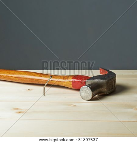 Composition of hammer and nail