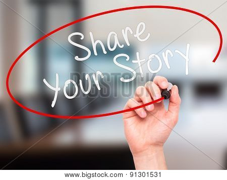 Man Hand writing Share Your Story with marker on transparent wipe board.