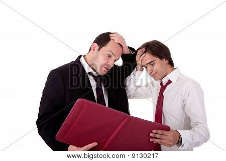 Two Businessmen Talking About Work, Tired And Worried, Looking For A Document, Isolated On A White B