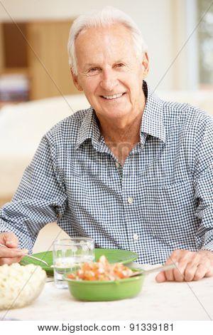 Senior man eating meal poster