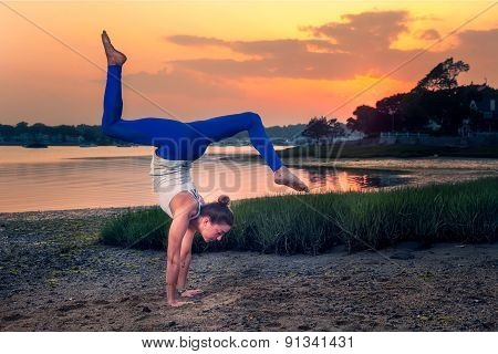 Female Model Adho Mukha Vrksasana Variation Handstand Beach