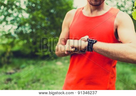 Runner Looking At Sport Watch Smartwatch